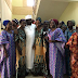 Newly rescued Chibok girls looking all cleaned up in a group picture with Senator Ali Ndume