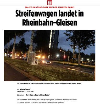 http://m.bild.de/regional/duesseldorf/polizei-streifenwagen/streifenwagen-landet-in-gleisen-52780954.bildMobile.html