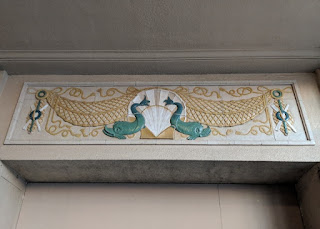 Carved banner with pair of fish atop a doorway inside the arcade, Asbury Park, New Jersey