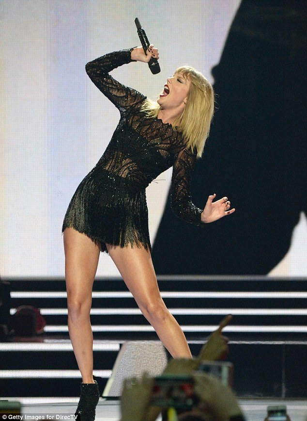 Taylor Swift flaunts legs at the DirectTV Super Saturday Night Concert in Houston