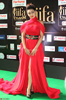 Apoorva in a Stunning Tight Leg Split Sleeveless Red Gown at IIFA Utsavam Awards 09.JPG