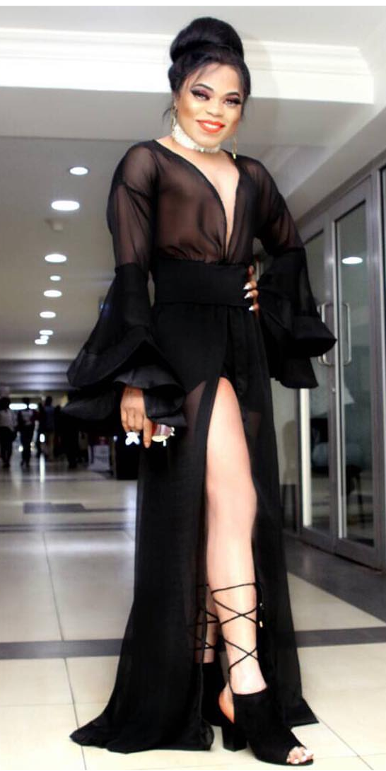 Bobrisky flashes major leg and 'cleavage' in plunging sheer gown