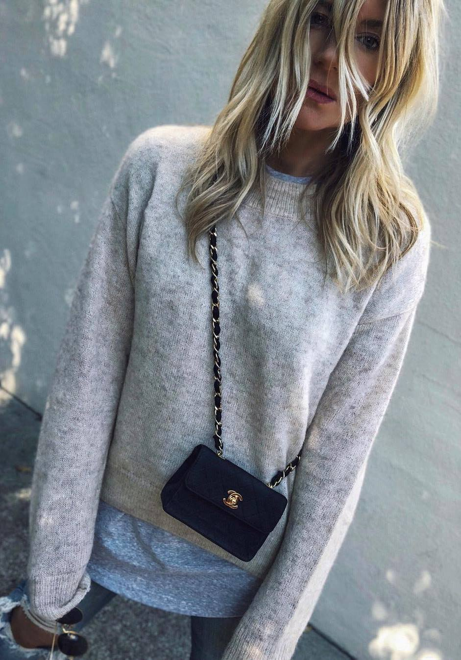 what to wear with a crossbody bag : oversized sweater + top + jeans