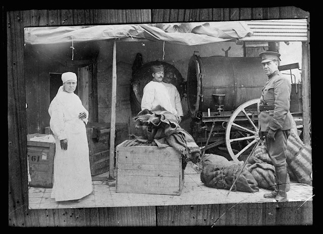 Miss Robia Whedon, Dr. McCarthy and Serbian Helper, with disinfection machine formerly used by Germans