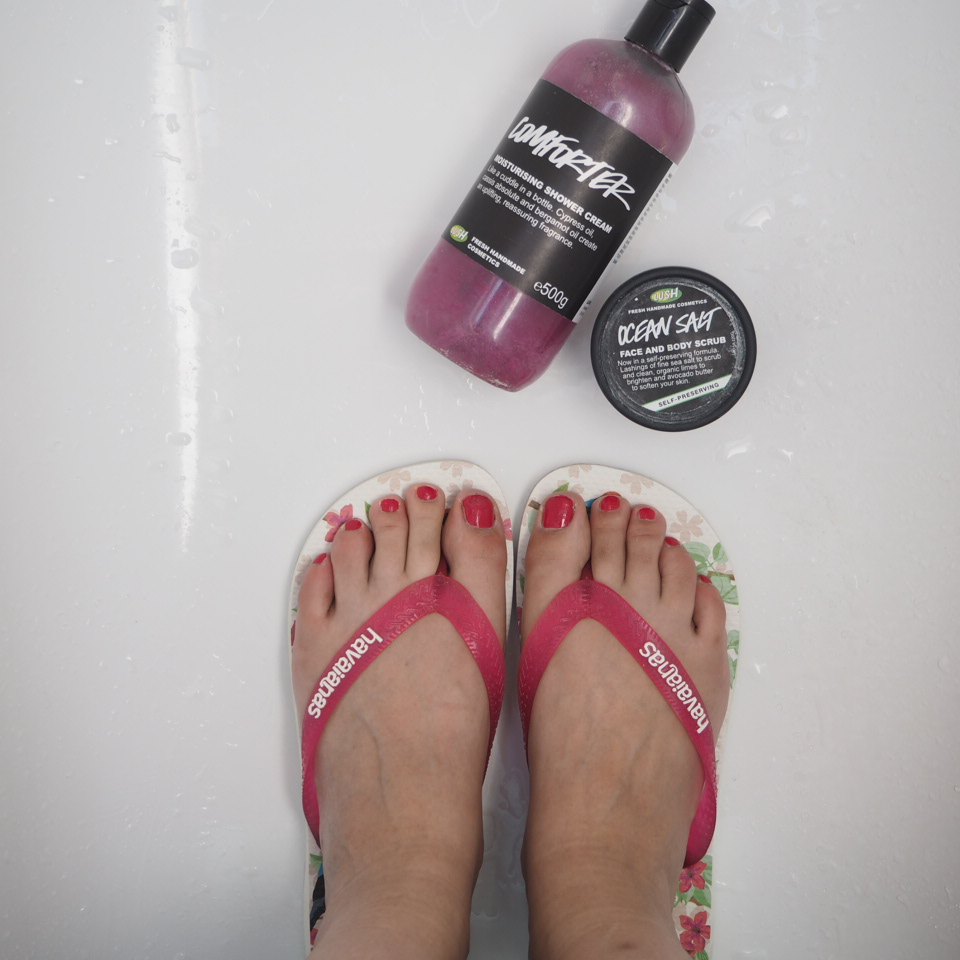 Flip flops, shower gel and face scrub from Lush
