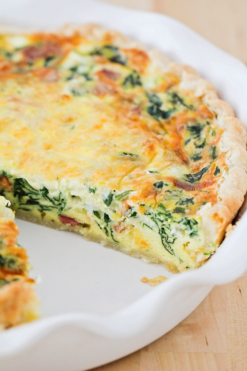 This savory and cheesy spinach and bacon quiche is so delicious, and easy to make!