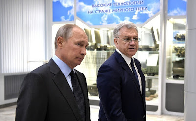 Vladimir Putin with Director of Almaz-Antey Air and Space Defense Corporation General Yan Novikov.