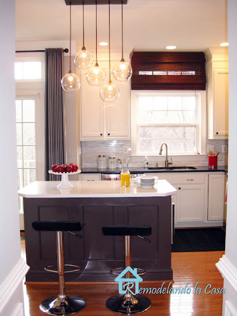 kitchen renovation with roman shade, Firefly pendant light, painted cabinets,