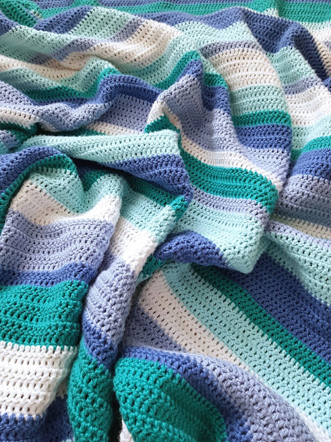 Beautiful cute and easy stripy crochet blanket.