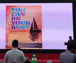 You can be your Best by Heryani Jamaludin (at podium) is another of the books launched at the Club HEAL event.