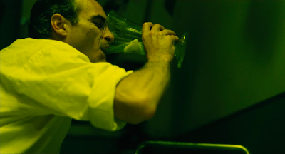 Joaquin Phoenix as Freddie Quell in The Master, drinks the coctailed booze, directed by Paul Thomas Anderson