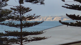 View to Cape Kidnappers from motel room, over the roof of the aquarium