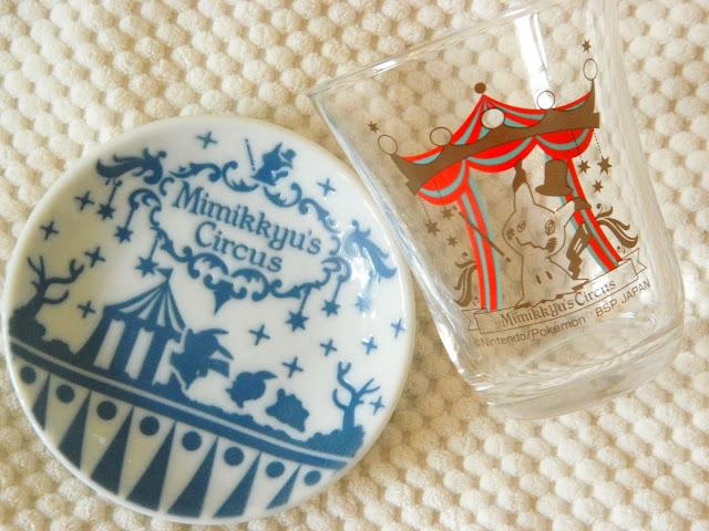 Two prizes from a Pokemon Mimikyu ichiban kuji, a plate and a glass