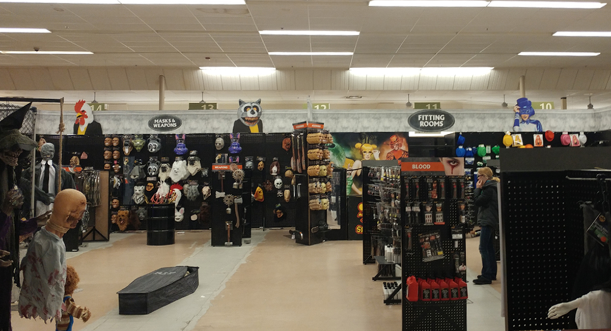 half of the store is being used for halloween spirit you can see the aisle markers are still hanging just beyond the rear displays