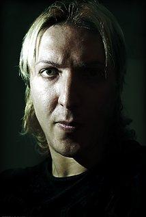 Giulio De Santi. Director of Adam Chaplin