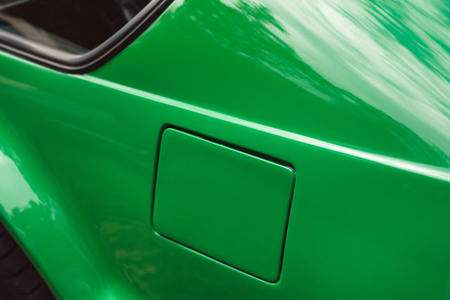 Photo of a green car's fuel tank
