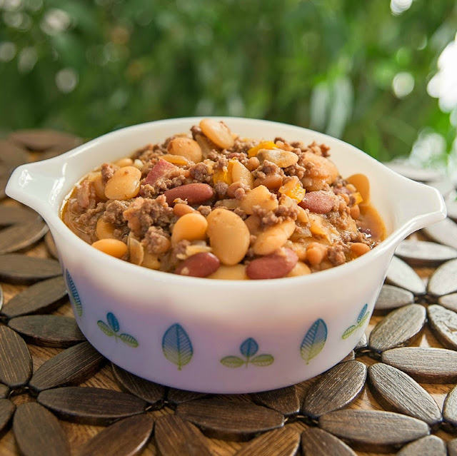 These Calico Beans made with ground beef, bacon, bell pepper and three kinds of beans is the ultimate comfort food side dish! Perfect for summer BBQ's or Sunday dinner in the winter time!