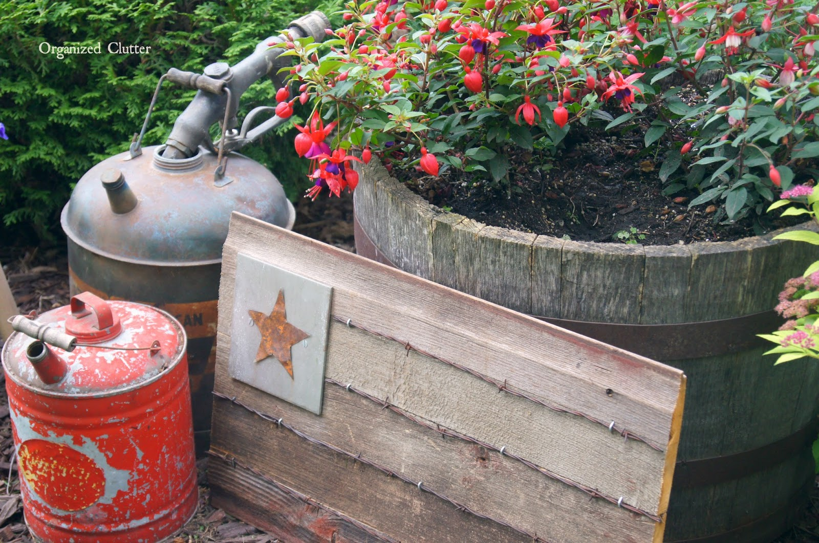 Oil Cans, Rustic Flag & Gas Nozzle www.organizedclutterqueen.blogspot.com