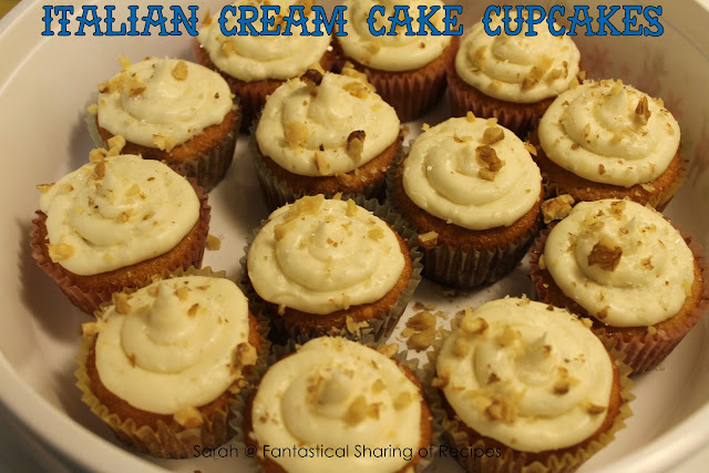 Italian Creme Cake Cupcakes - a sweet vanilla-y cupcake topped with a delicious cream cheese frosting and walnuts. #cupcakes #cake #dessert