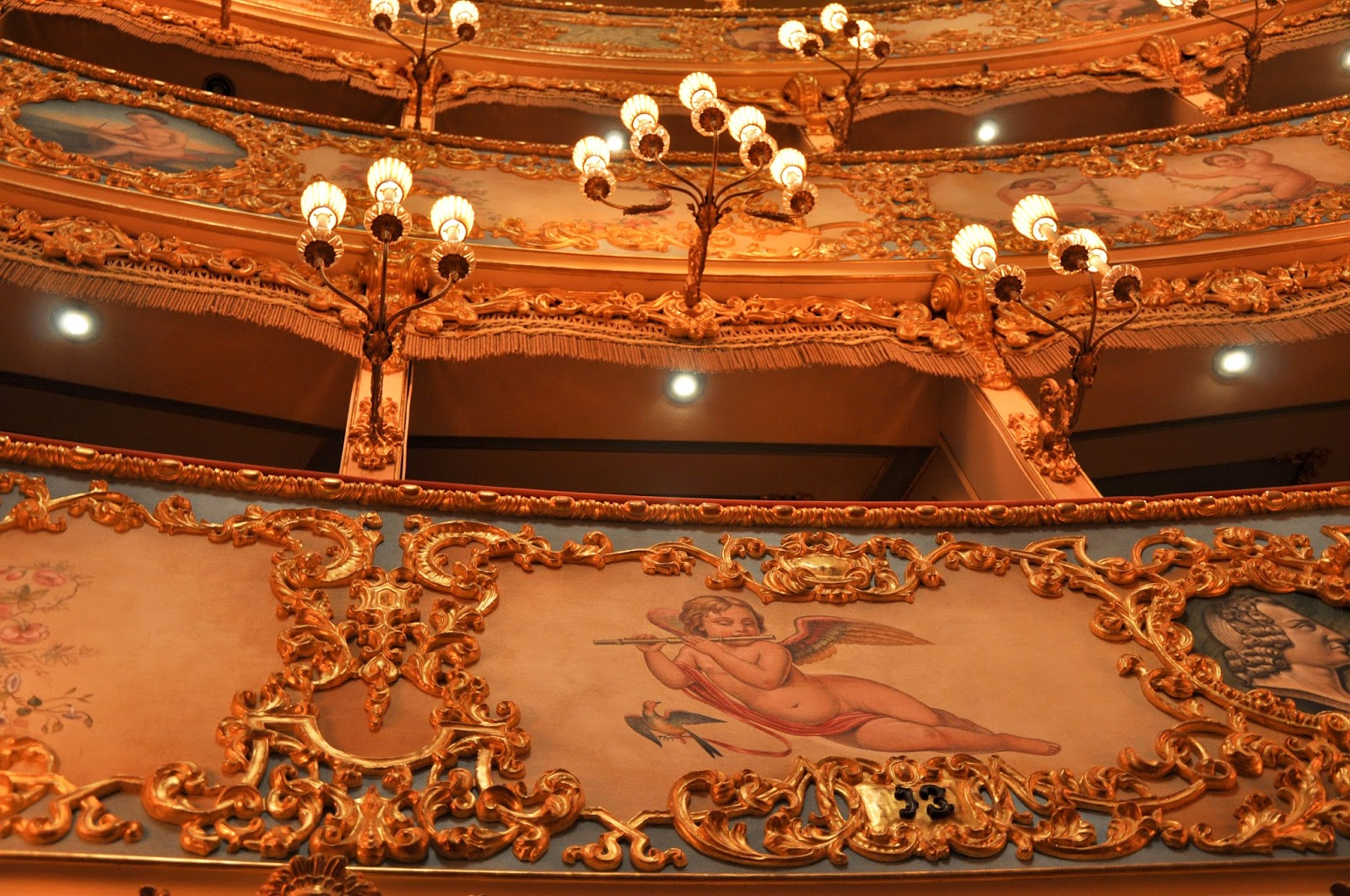 A close up of the lights and the ornamenation of the boxes, La Fenice, Venice, Italy