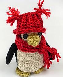 http://www.redheart.com/free-patterns/little-penguin-ornament