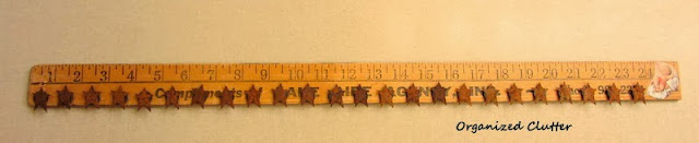 Junker's Re-Purposed Yardstick Advent Calendar www.organizedclutterqueen.blogspot.com