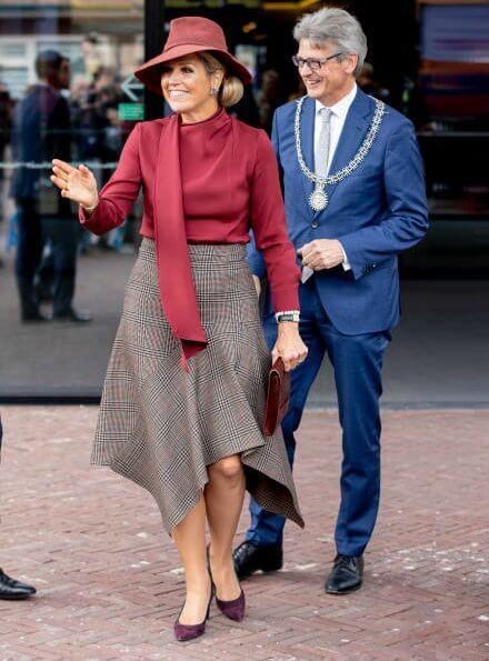Queen Mathilde wore asymmetric midi skirts and Natan red blouse, Gianvito Rossi bicolor suede pumps, Fabienne Delvigne hat