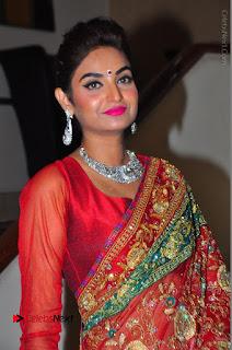 Model Sharon Fernandes Stills in Red Saree at Trendz Exhibition Launch  0010.JPG