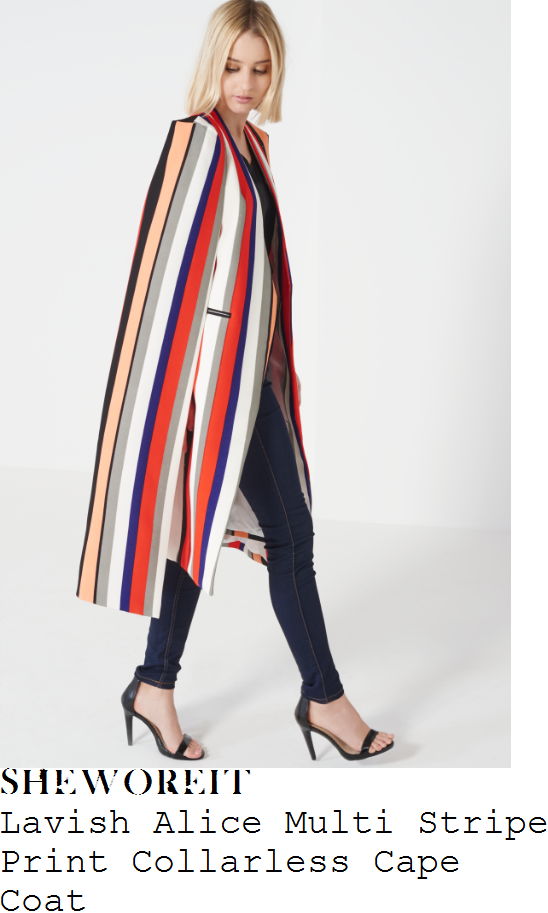 alesha-dixon-lavish-alice-orange-cobalt-blue-white-grey-and-multicoloured-vertical-stripe-print-structured-shoulder-detail-collarless-midi-length-cape-coat