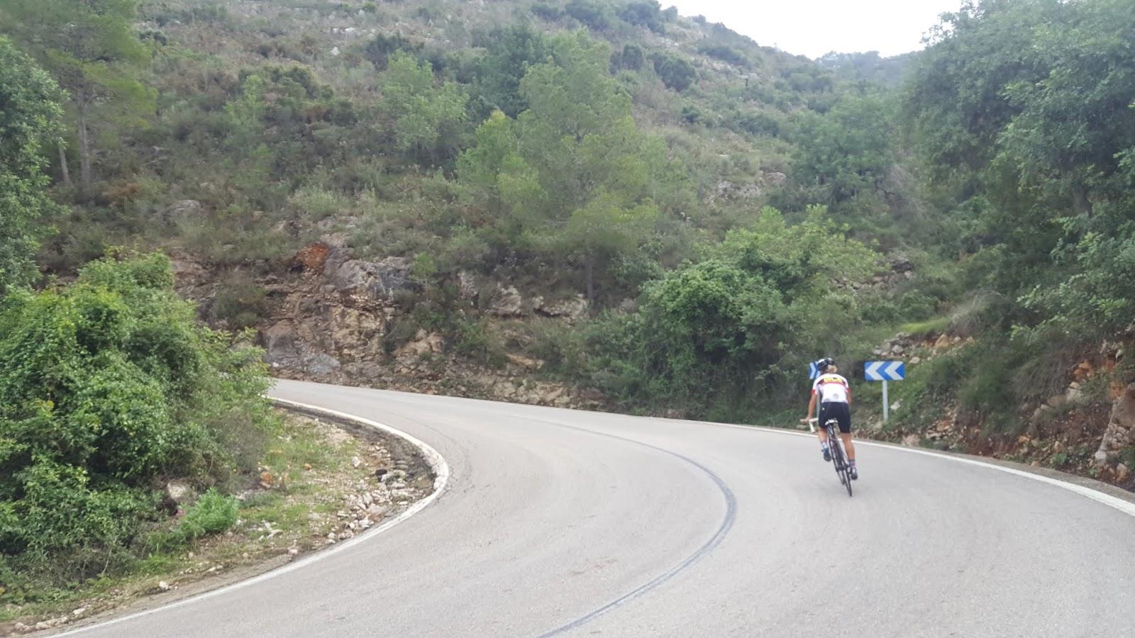 Cyclist climbing Puerto de Barx, Valencia