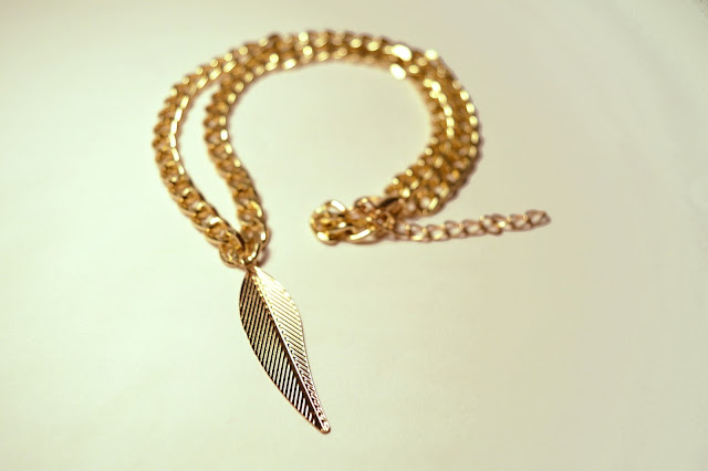 Chipina gold plated necklace with feather pendant