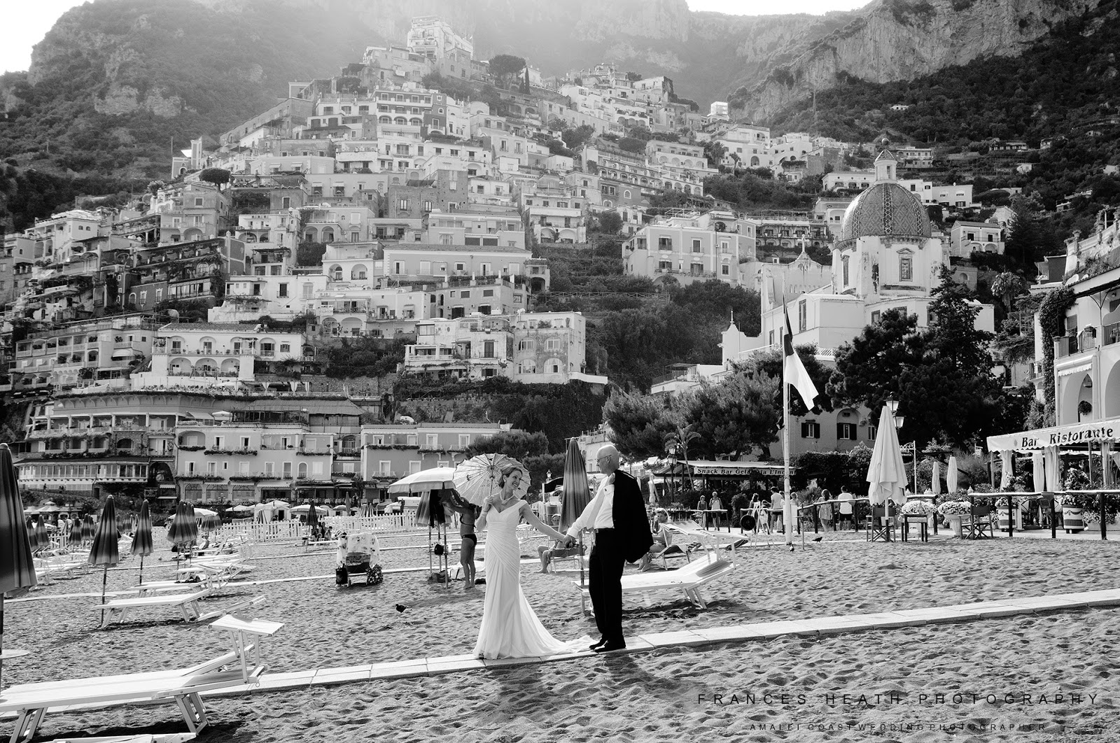 Bride and groom on Positano beach