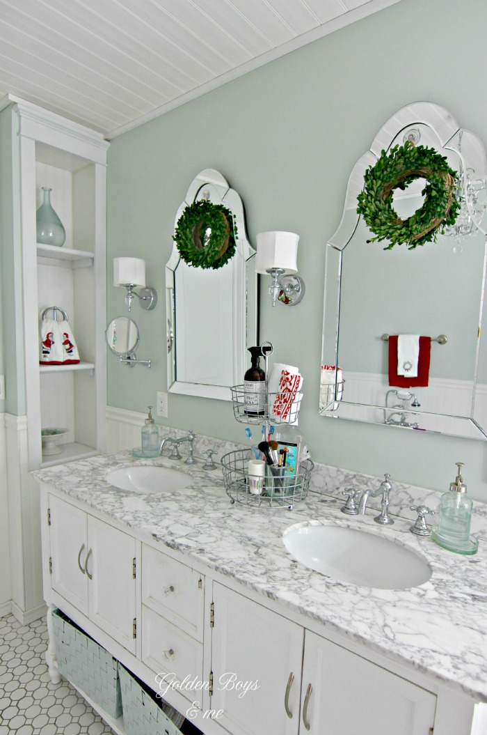 Hovan mirror with boxwood wreaths in DIY Master Bathroom - www.goldenboysandme.com