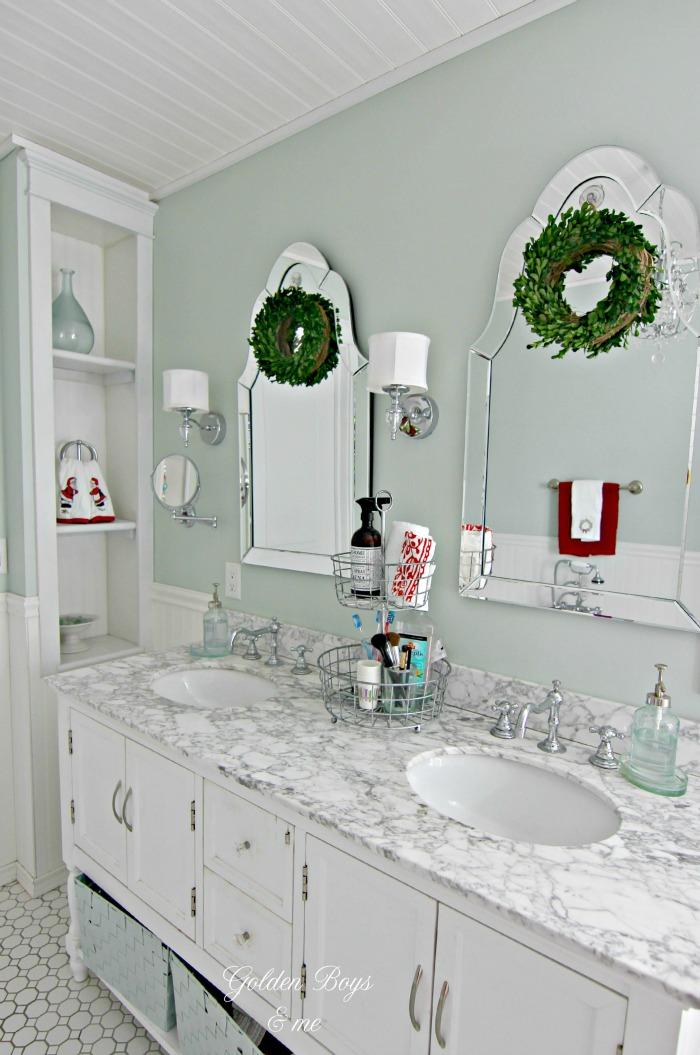 Hovan mirror with boxwood wreaths in DIY Master Bathroom - www.goldenboysandme.com