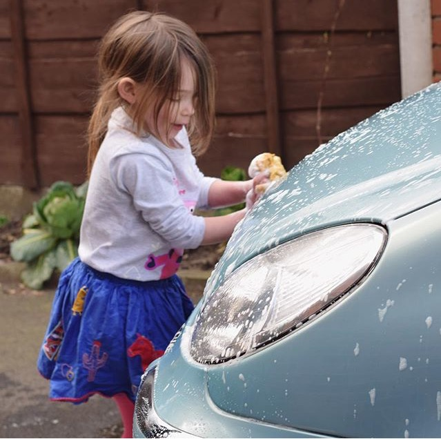 little girl washing car