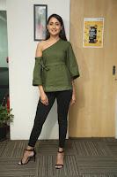 Pragya Jaiswal in a single Sleeves Off Shoulder Green Top Black Leggings promoting JJN Movie at Radio City 10.08.2017 071.JPG