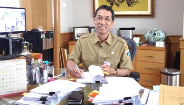 Kepala BPKAD DKI Jakarta Heru Budi Hartono di ruang kerjanya