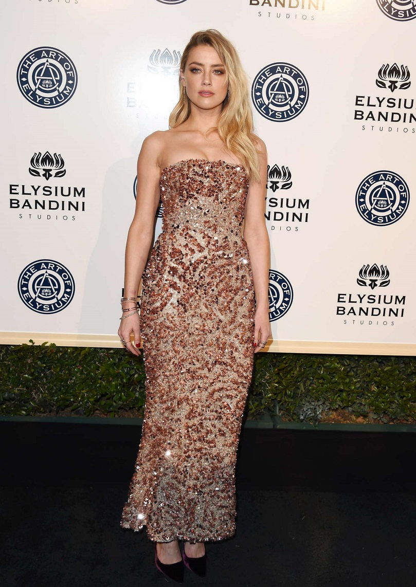 Amber Heard goes strapless for the Art of Elysium Gala in LA