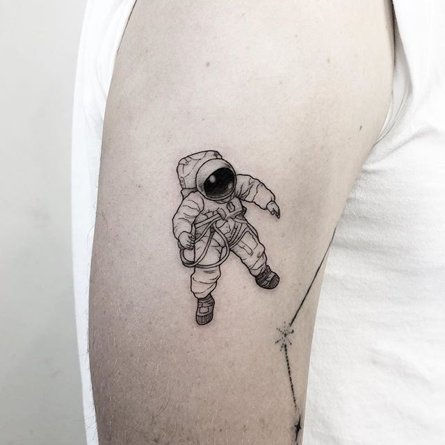 small astronaut tattoo