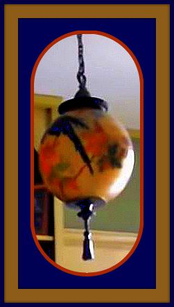 globe painted with blue parrot, orange flowers hanging from library ceiling in Webber house