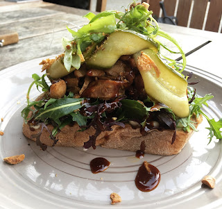 Shredded duck open sandwich with  pickled cucumber, spring onion and hoisin