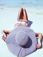 marbella escort on beach large sunhat
