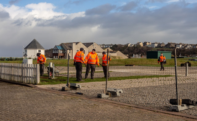 Photo of workers laying turf on the caravan site last week