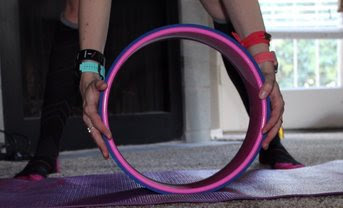 back stretch forward fold yoga wheel