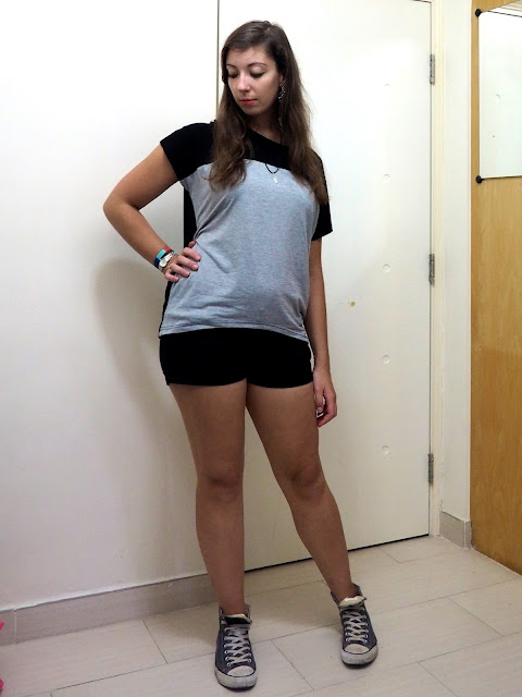 Thundercloud | casual outfit of grey and black loose t-shirt, black denim shorts and blue high top Converse