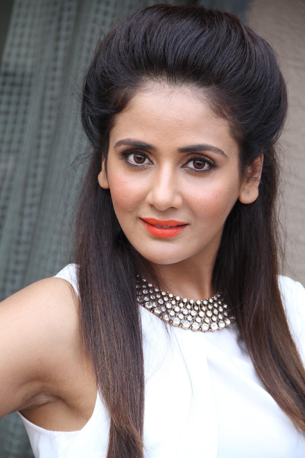 Actress Parul Yadav Face Close Up Photos In White Dress