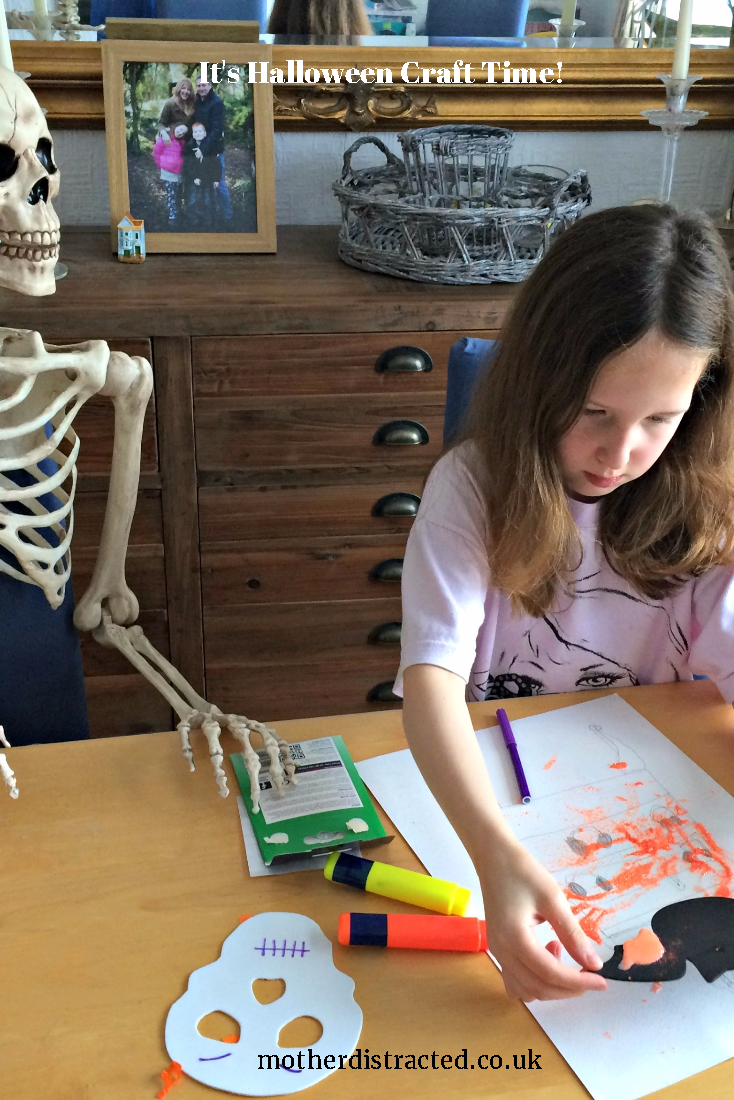 picture hanging solutions - Caitlin crafting with Mr Bones, the family skeleton