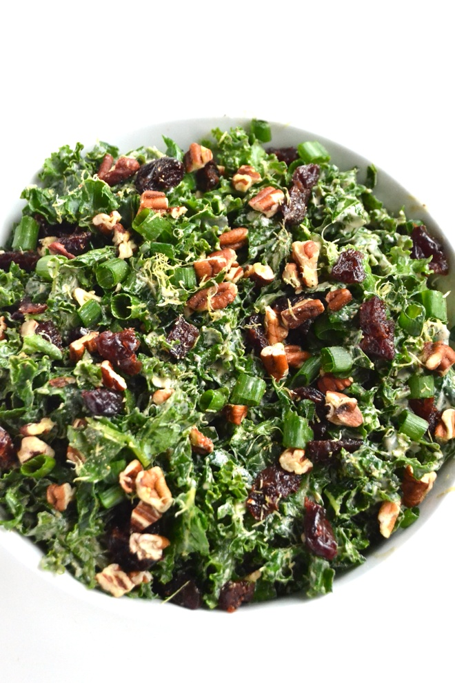 Kale Salad with Lemon Yogurt Dressing takes 5 minutes to make and is packed with nutrients and flavor for the perfect side dish for any day! Top with your favorite protein for a complete meal. www.nutritionistreviews.com