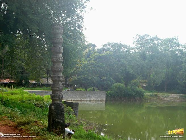 Stone pillar by a pond opposite to Chaulikeri temple, Barkur, Udupi district, Karnataka, India