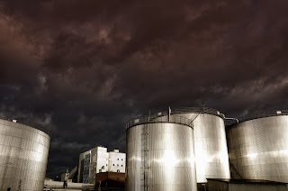 outdoor petroleum storage tanks at industrial facility